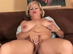 Soccer mom works her mature pussy with a dildo