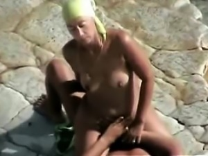 Candid beach footage of a horny cougar