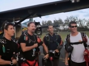These badass babes water surfing and skydiving in Hawaii