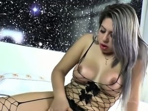 Busty TS Julie makes pleasure with dildo