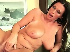 Busty mom gives her lickable pussy a treat