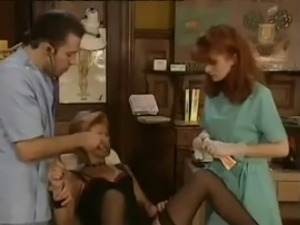 Redhead Doctor Gives Gyno Exam with Her Fist