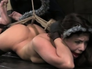 Gagged and hogtied sub has pussy teased