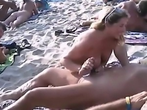 Blowjobs  and sex on a nudist beach
