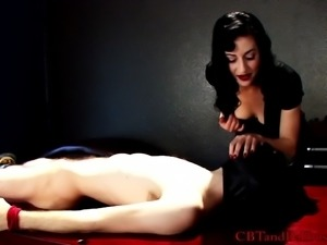 Beautiful dominatrix with an awesome body torturing a stranger