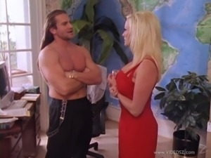 Captivating blonde with fake tits awarding her guy with blowjob