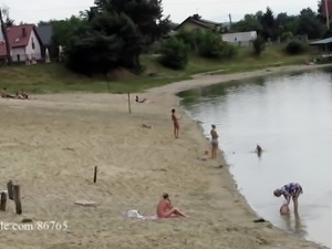 Ola walking alone naked on a public beach (voyeur version)