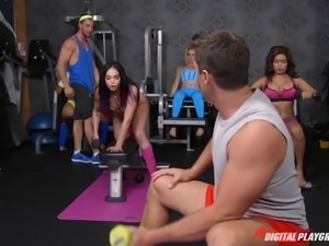 Sexy guy at a gym bends over a cute brunette for a fuck