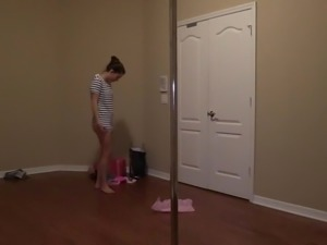 Amateur girl poledancing while she changes in and out of outfits