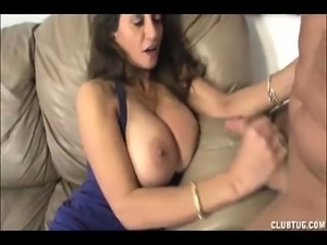 The startled mom becomes horny and begins jerking his cock