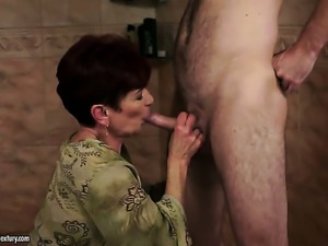 Redhead is on fire in steamy oral action with hot guy