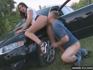 Outdoor sex fun with sexy brunette hottie right on a car hood