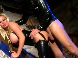 Busty Blonde MILF In Black Latex Fucks Slave