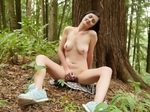 Busty Rita Toys Her Pussy In The Forest