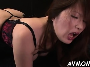 Asian milf acquires partial shaved muff hammered from behind