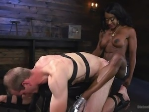 He is tied up, unable to defend against the powerful woman even, if he wanted...