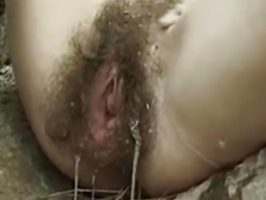 Stylish hairy women in the forest