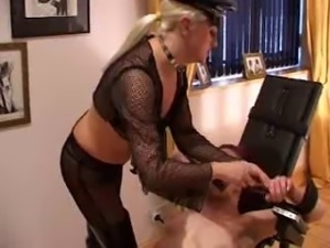 Mistress fucks slave-girl with the help of fucking machine