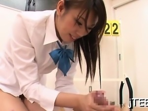 Alluring japanese schoolgirl fucks her hairy muff with toy
