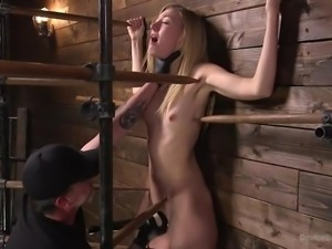 The master had this hot blonde tied up and held against the wall. He gets...