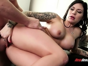 Buxom tattooed brunette gobbles cock and gets her cunny nailed